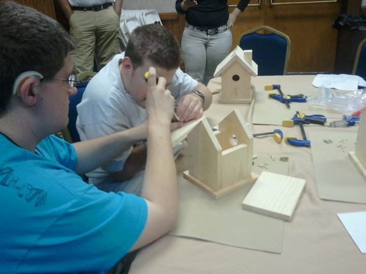 Teens working on their Bird House crafts